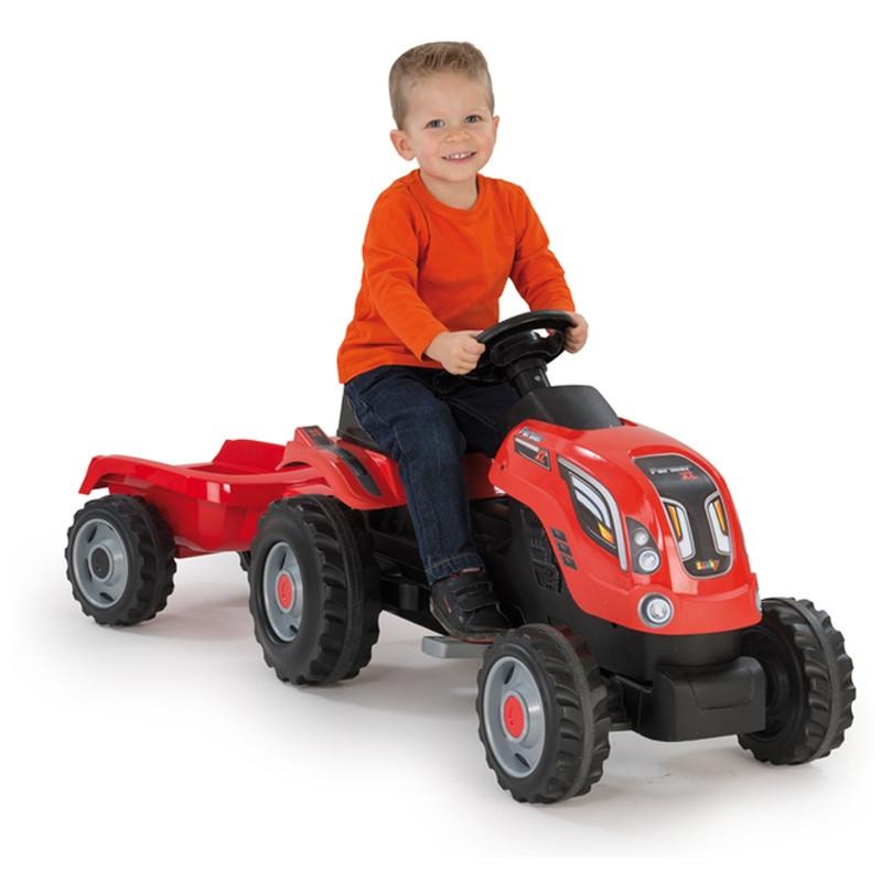 Trator Farmer XL a pedais com reboque vermelho